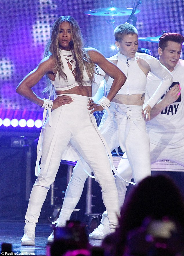 Ciara didn't disappoint this weekend as she delivered a rousing performance at the WE Day celebration in Seattle in a white halter cut-out top, white high-waist trousers, and a comfy pair of  Nike Air Force 1 Flyknit  sneakers.