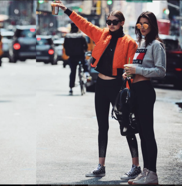 Gigi and Bella Hadid took NYC in epic sister style. Bella stepped out in Nike Air Force 1 High 'Suede' Sneaks paired with GracedbyGrit leggings, Quay Circus Life Sunnies and a cropped Tommy Hilfiger Denim Flag Sweatshirt.  Gigi was a bright spot in Vans 'Love Me Love Me Not' Sk8-Hi Sneaks and a V Files Orange Cropped Bomber jacket.