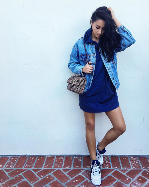 Shay Mitchell posted up with some major grape action in the Air Jordan 5 Retro 'Grape' paired with an oversized sweatshirt, a Levis denim jacket and a perfect Chanel tweed handbag.