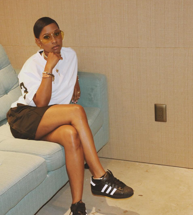 DeJ Loaf posted up in her b/w fly in the adidas Superstar Black/White.