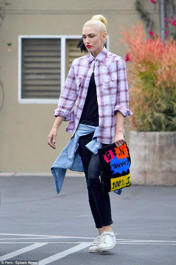 Gwen Stefani brought us back to the No Doubt days as she gave us weekend grunge in a plaid button-down, Adidas Originals Superstar Leather Sneakers and a Chanel Shearling Clutch.