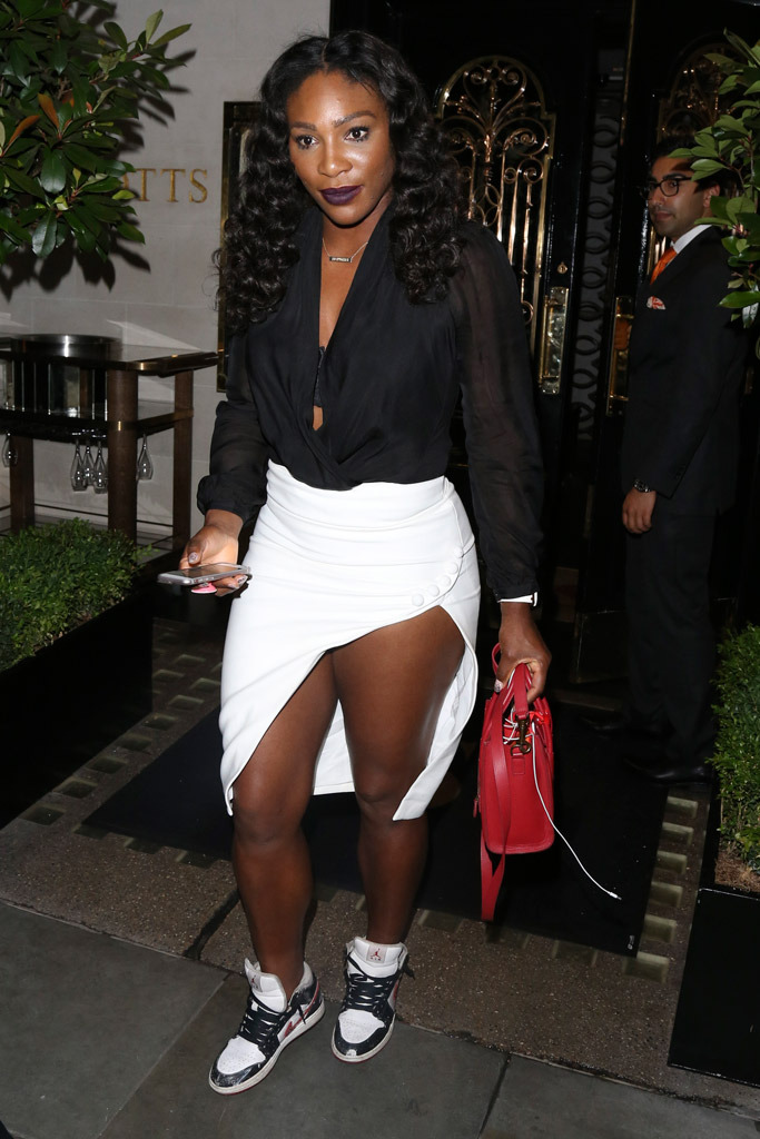 Defending Wimbledon champ Serena Williams stepped out this week for a pre-tournament party in London. The Nike star athlete swapped out heels for a pair of Air Jordan 1 sneakers paired with a high-slip skirt and a sheer blouse.