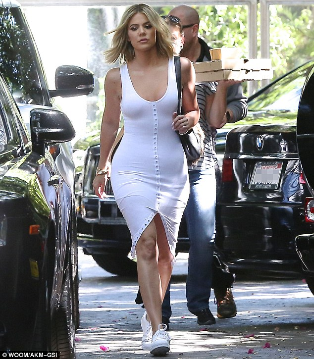Khloe Kardashian strutted her stuff and definitely caught our attention in a button-down midi dress and in the adidas Superstar White/White.