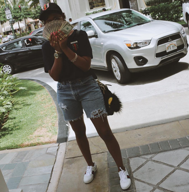 Dolla Dolla Bill: DeJ Loaf flashed her bands and kept it cute in cutoffs and Gucci sneakers.