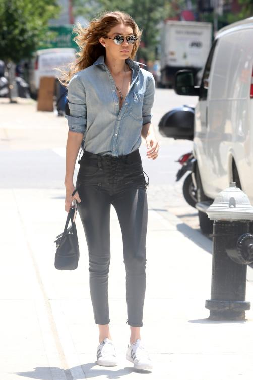 Gigi Hadid made a second impression this week wearing Adidas Originals Superstar Sneakers, Unravel Black Stretch Leather Pants, Illesteva Milan Sunglasses in White Tortoise and a Versace Palazzo Empire Bag.