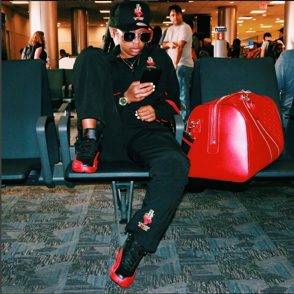 Dej Loaf waited to take the skies over the weekend.  The rapper posted up in the terminal (on on Instagram) in a pair of the Air Jordan 12 'Flu Game'