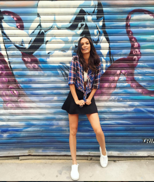 More Puma Creeper love as Joan Smalls kept it coy in a black mini and plaid button down.