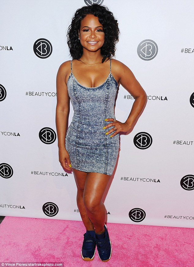 Christina Milian brought all of the smiles to BeautyCon LA over the weekend.  The beauty brand owner paired a skintight  acid wash denim mini dress  from her own We Are Pop Culture line with a pair of  Air Jordan 11 Retro Low 'Navy Gum'  sneaks.