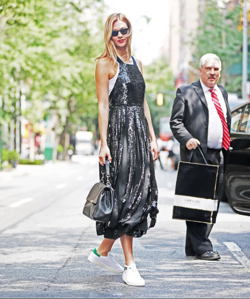 Karlie Kloss stepped out FLY in NYC sporting Warby Parker Downing Sunglasses, adidas Stan Smith Sneakers, and a gorgeous Tibi Eclair Overall Dress.