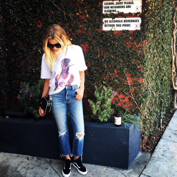 Ashley Benson posted up with some greenery in Los Angeles wearing Vans Old Skool sneaks, Celine Cl 41076/S Tilda Sunglasses, and an awesome Michael Jordan Retro Cigar tee by The Holy Couture.