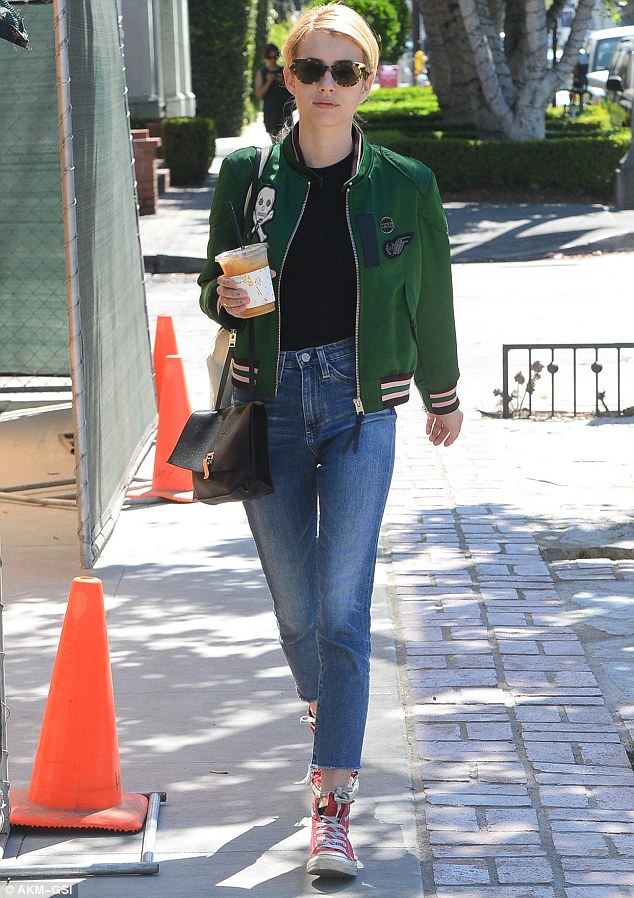 Emma Roberts hit the streets for a coffee run in La La Land wearing Converse Chuck Taylor Classics, a Coach 1941 Resort 2017 Jacket, and AG 'Farrah' Skinny Crop Jeans in 10 Years Liberation.