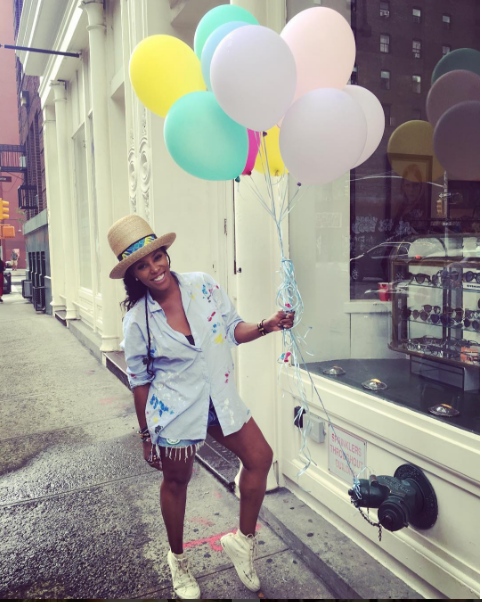 June Ambrose hosted her very own city pop-up yard sale last weekend and we spotted her getting rid of her closet clutter in a pair of beige Converse Classic High Tops.  Definitely wish we could have been there to grab some of her closet goodies.