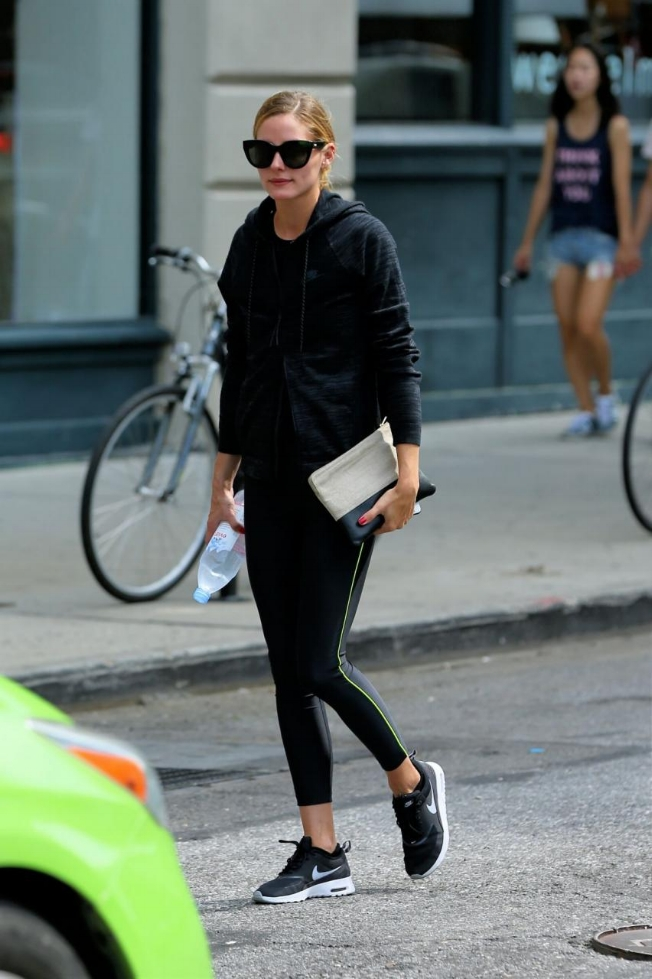 Olivia Palermo is always a house favorite. The stunner walked the NYC streets pre-workout in Nike Air Max Thea sneaks paired with a Nike Tech Cotton Wind Runner Jacket, Perverse Alpha Sunnies and a Celine Solo Smooth Lambskin Bi-Color Clutch.