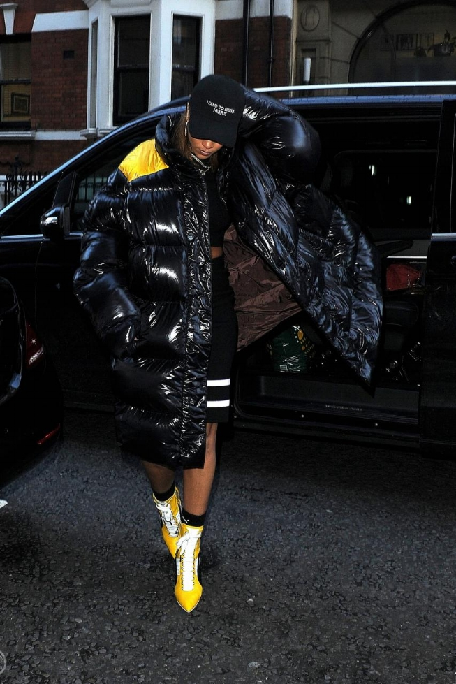 Rihanna may not have been rocking sneaks, but her Puma fashion was in full effect this week as she hit cobblestone streets in a pair of sneaker heels from the new collection, a black Raf Simons Down Oversized Coat, Puma Men's Crew Socks, and a Nasa Season 'I Came to Break Hearts' Cap.