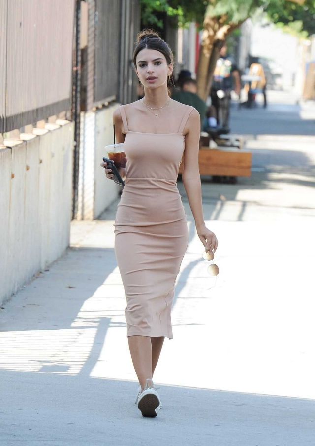Model Emily Ratajkowski made her rounds around Los Angeles looking blush-worthy in Converse Chuck Taylor All Star sneaks and a midi Lpa 27 Dress.