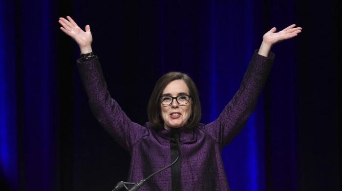 Kate Brown; Photo:  Steve Dykes/AP