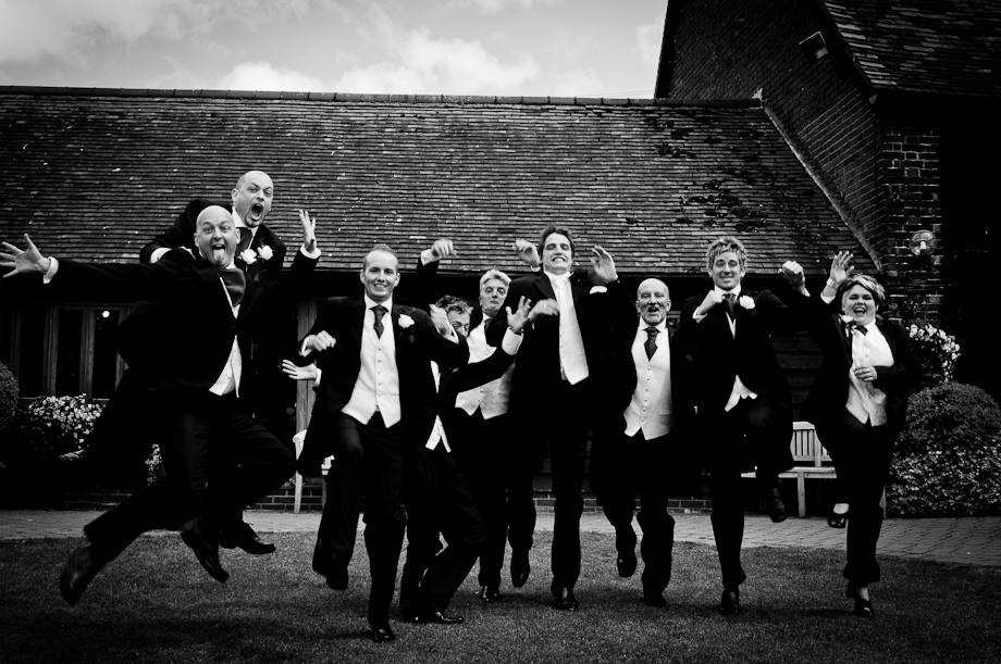 Not the most masculine jump at Cooling Castle wedding