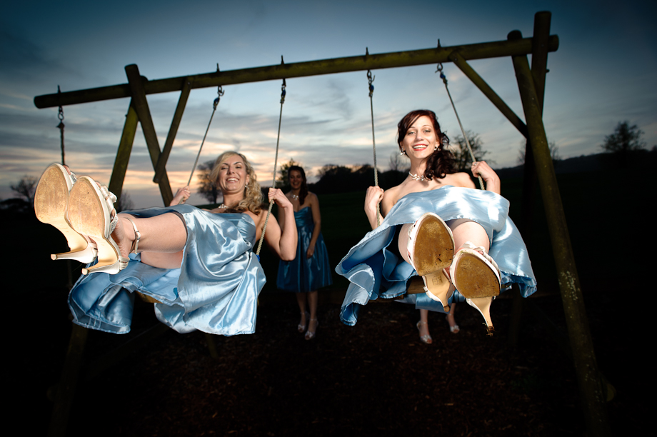 Bridesmaids on the swings at Eastwell Manor