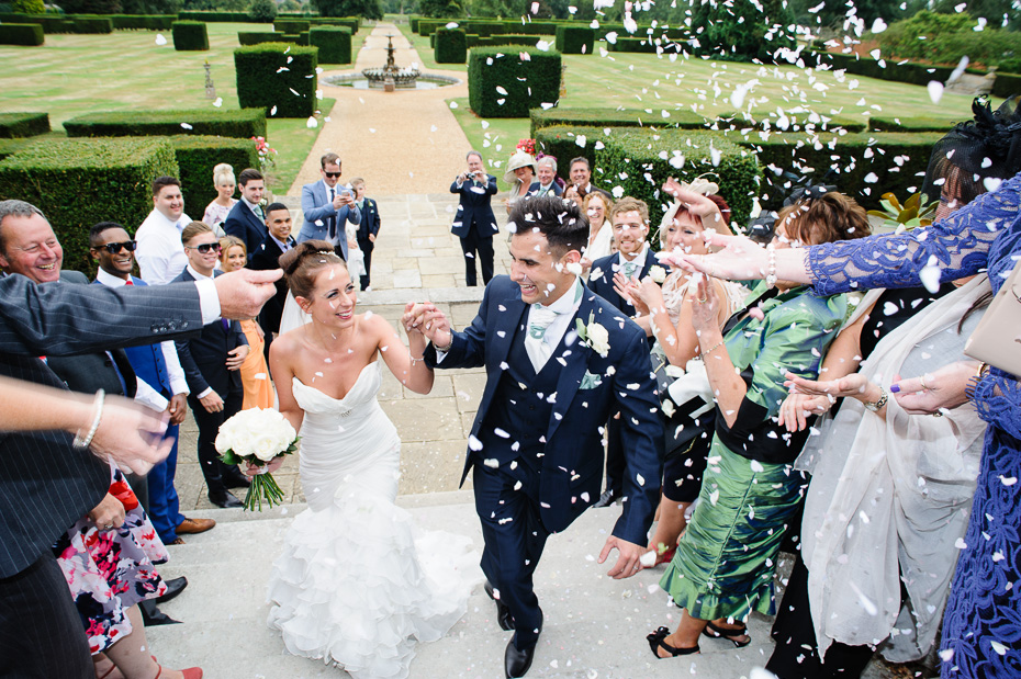 Confetti - Bride and Groom at Eastwell Manor - Kent Wedding Photography