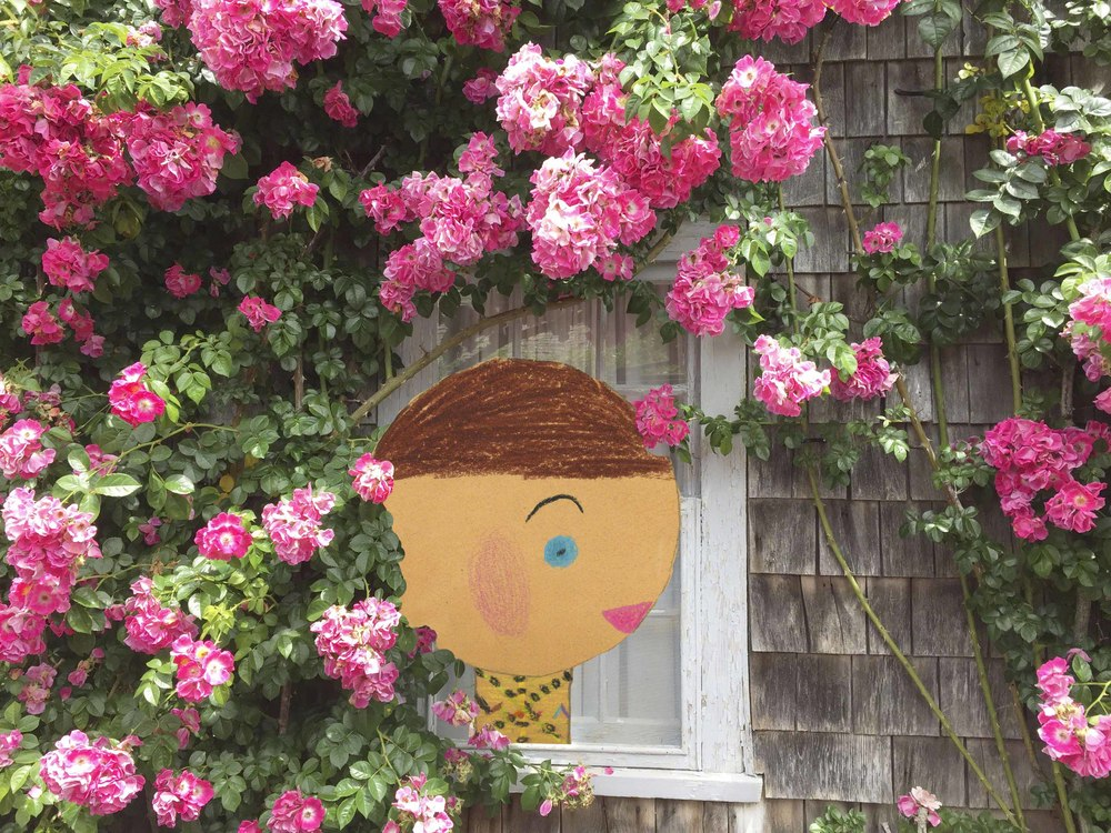 Low Res Girl in Rose cottage window.jpg