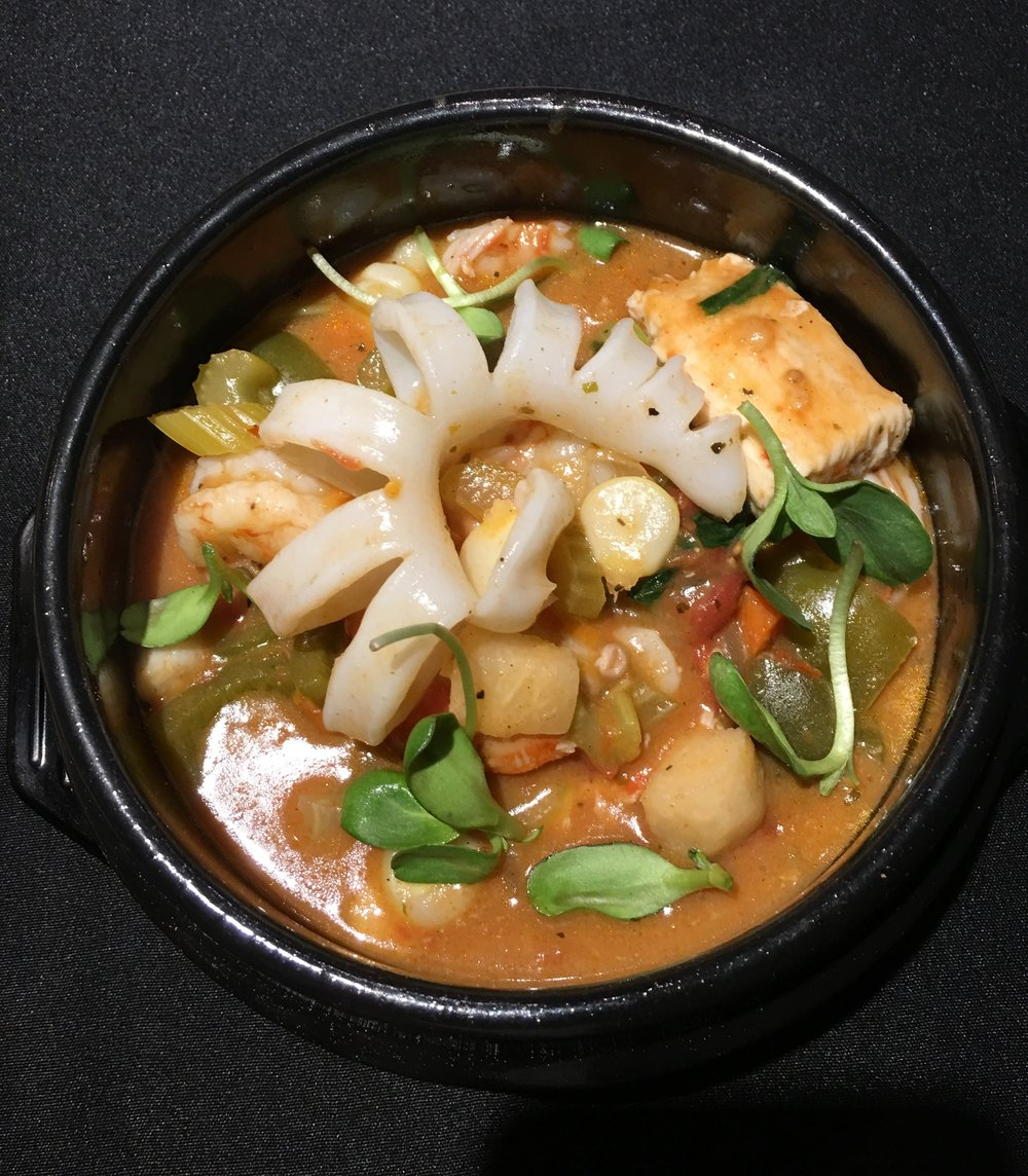 Sudado - Peruvian Seafood Stew w/ Fish, Calamari, Scallops, Shrimp, Jicama, White Corn, Sweet Potato, Aji Peppers, Spicy Tomato Clam Broth
