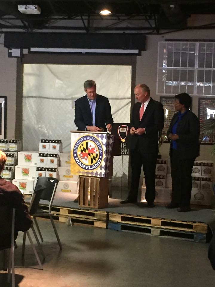 Kevin Atticks (Brewers Association of Maryland) and Comptroller Peter Franchot giving out recognitions.