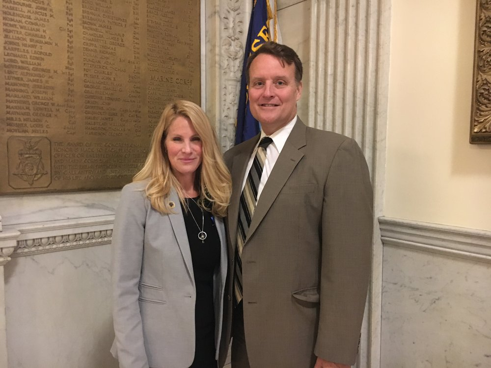 Senator Michael O. Moore with Trish Tarentino, the wife of the late Officer Ronald Tarentino, Jr.
