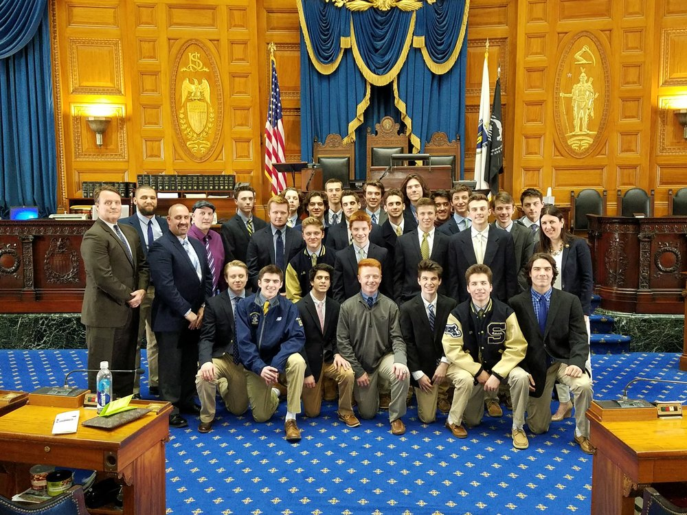 Senator Michael Moore and Representative Hannah Kane hosting the Shrewsbury High School Boys Hockey Team in the Chamber of the Massachusetts House of Representatives.