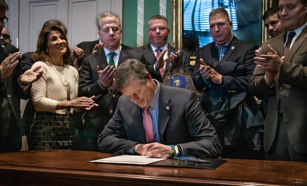 Senator Moore (far right) with Governor Charlie Baker (center), Lt. Governor Karyn Polito (left), legislators and first responders in the Corner Office of the State House.