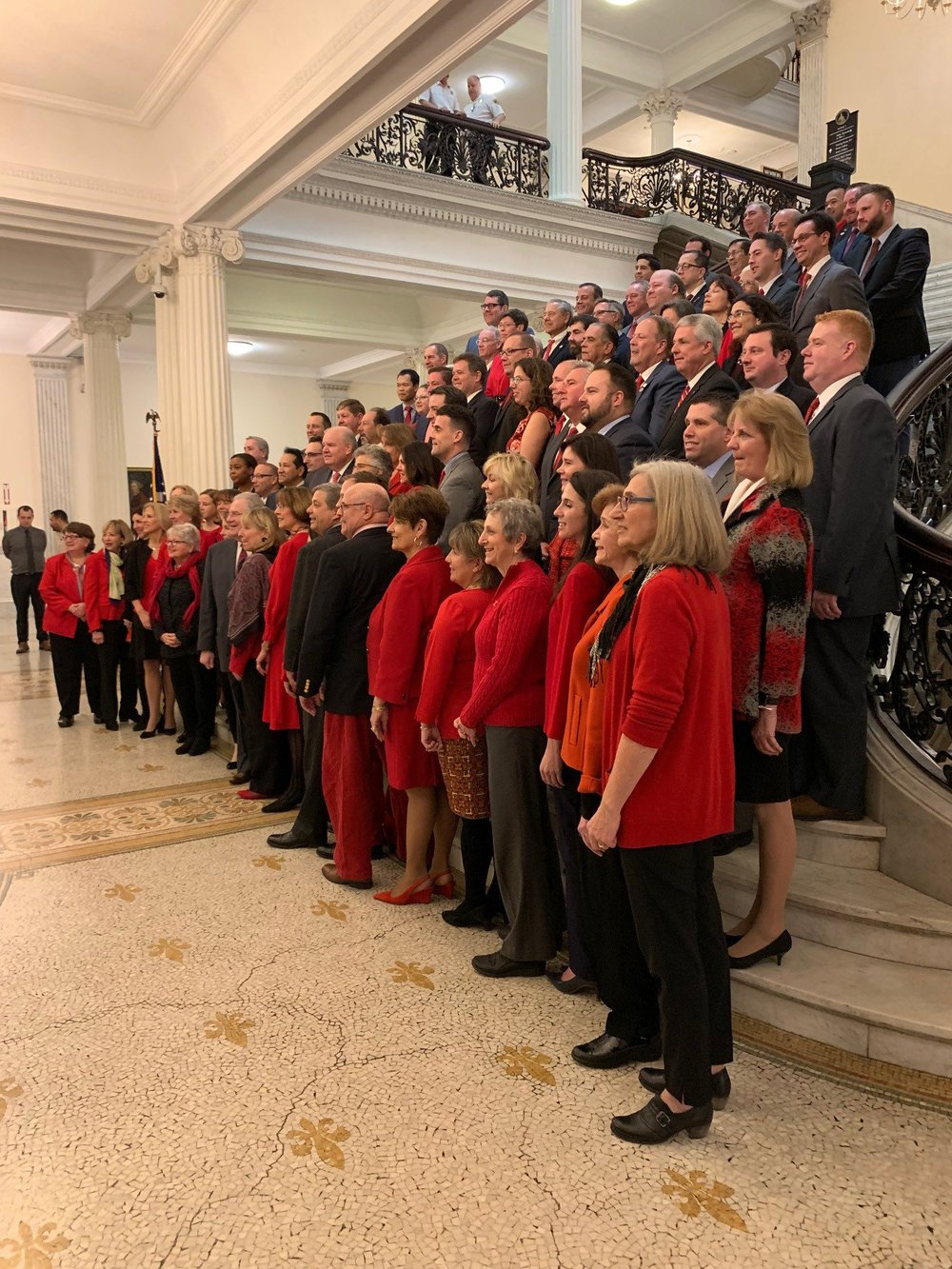 Dozens of legislators participate in the 'Go Red for Women' event at the Grand Staircase of the Massachusetts State House.