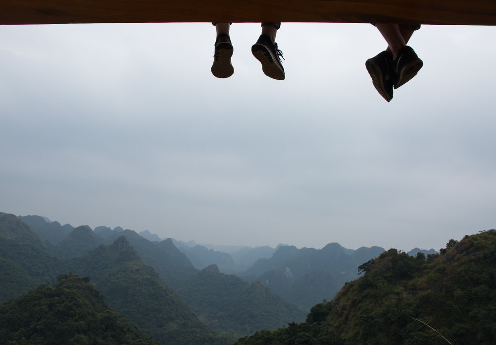 A couple observes the view from the top of Cat Ba Island, Vietnam.