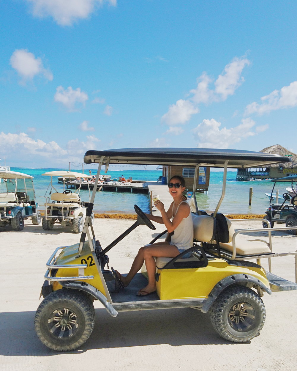 Driving a golf cart to get around town in San Pedro, Belize