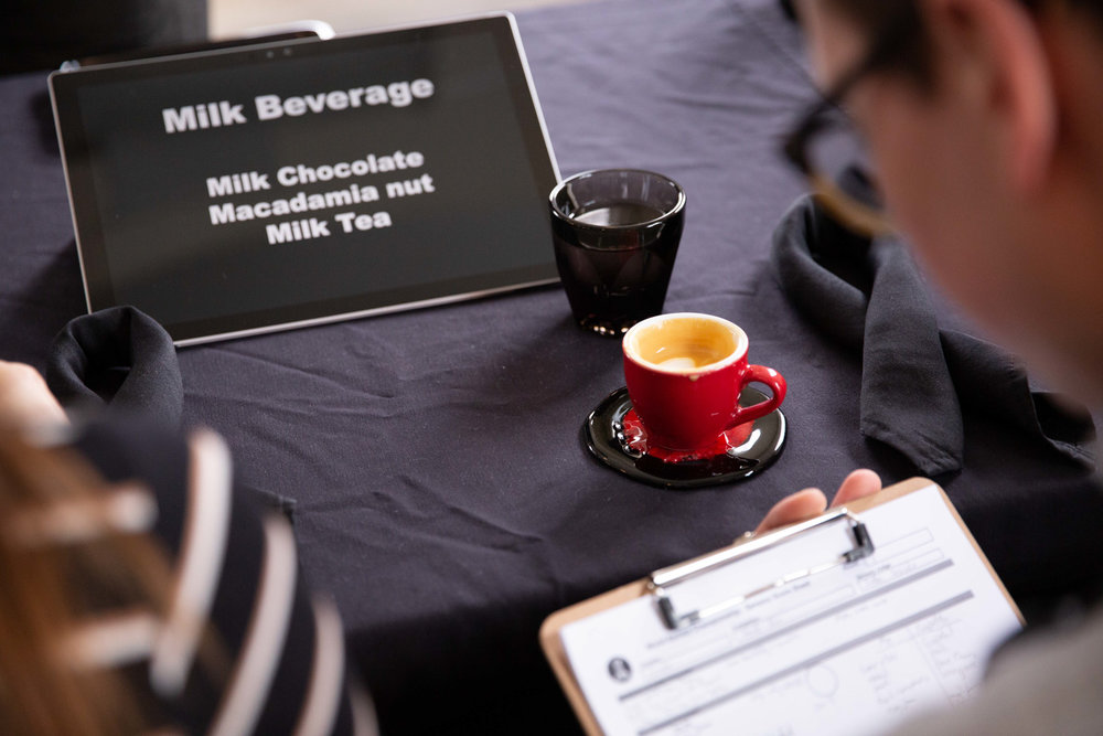 A judge marks down flavour notes of the coffee he is tasting at the 2019 National Barista Championships in Toronto.