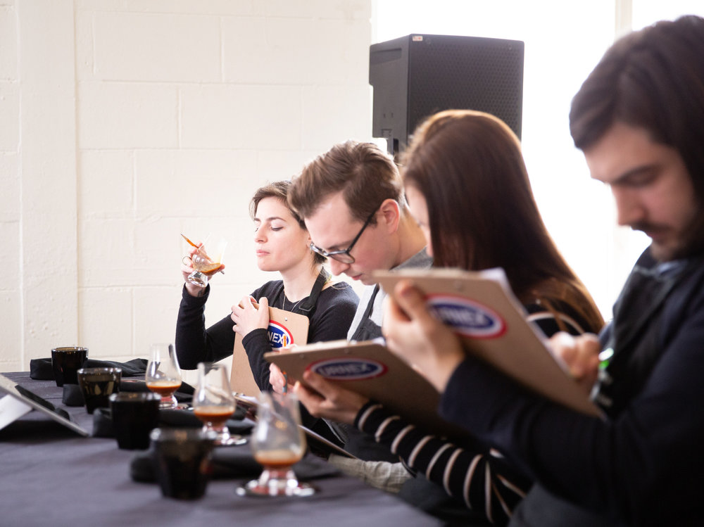 Judges taste test coffee at the Canadian Barista Championships in Toronto.