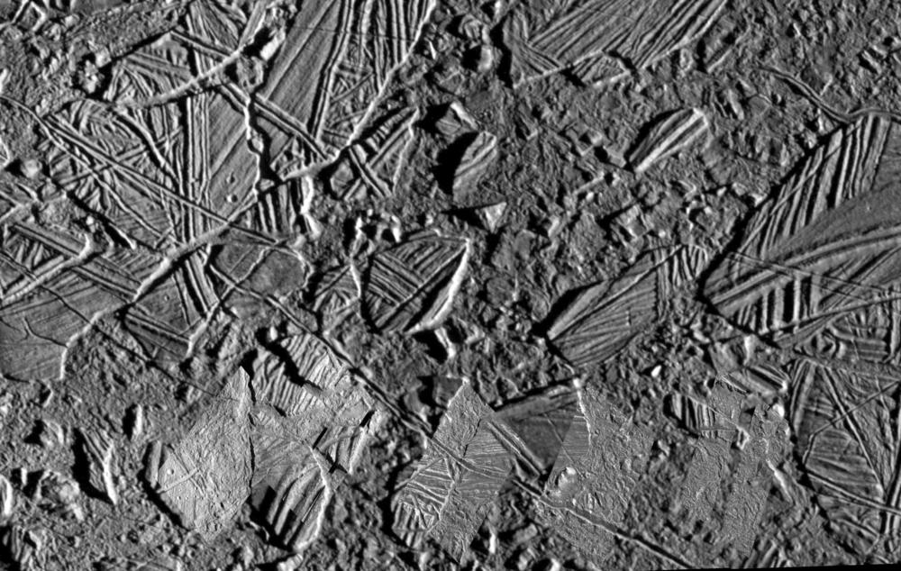 This image of Europa's surface was captured by the  Galileo  spacecraft during its time in the Jupiter system from 1995 to 2003. The broken-up chunks are basically icebergs from pre-existing ice crust that somehow was broken up when warm ice or water reached the surface.   (NASA/JPL/U. of A.  )