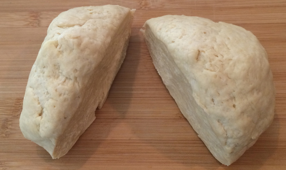 Divide the dough into two parts and flatten into disks.
