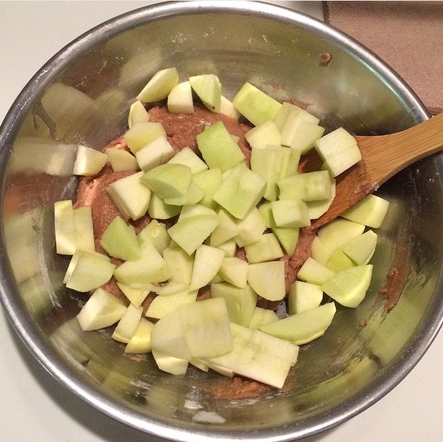 Add the apple slices to the batter, gently folding them in until evenly mixed.