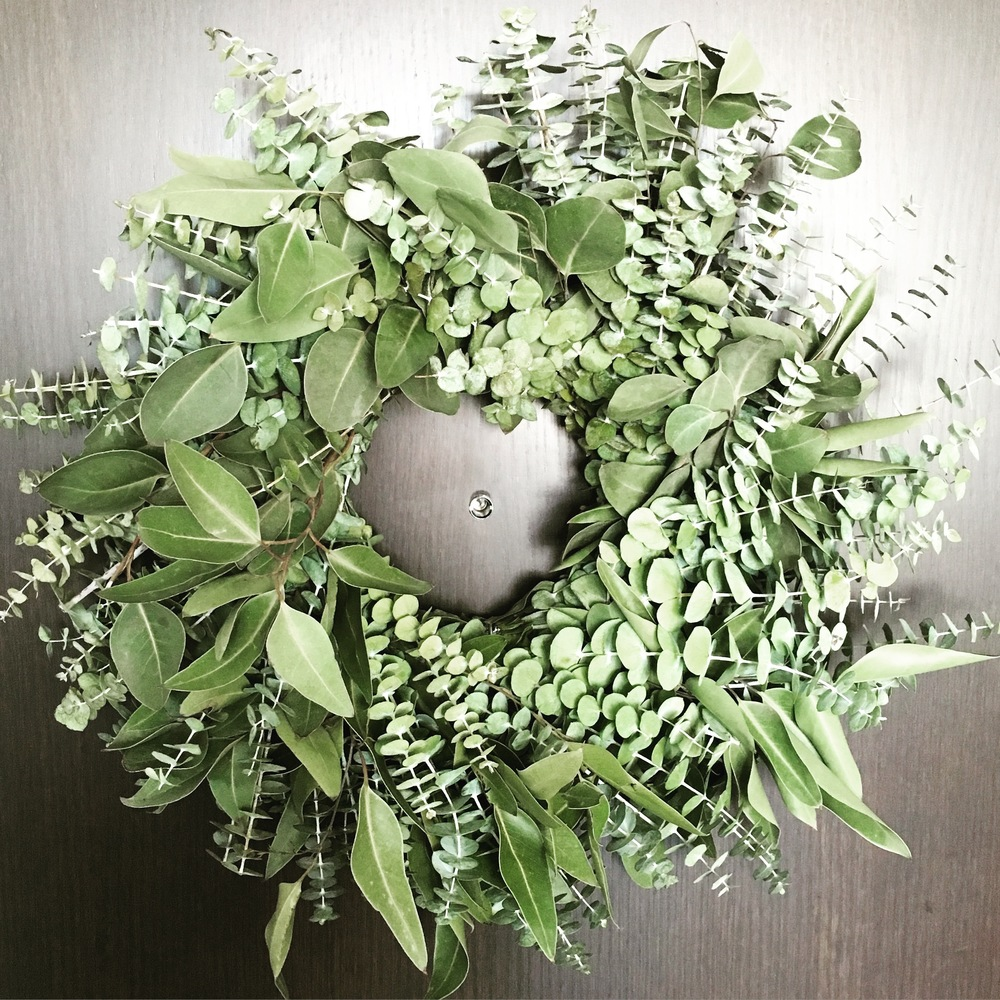 A fresh eucalyptus wreath from West Elm on our front door