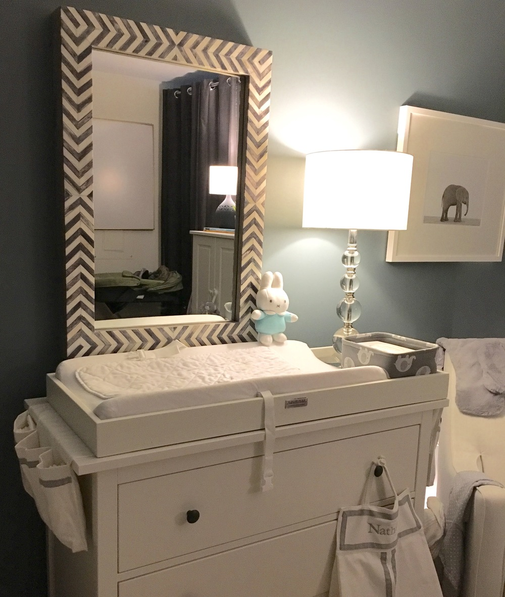 Ikea Hemnes dresser, RH Baby & Child Changing Topper, West Elm Parsons Wall Mirror, and The Animal Print Shop baby elephant print