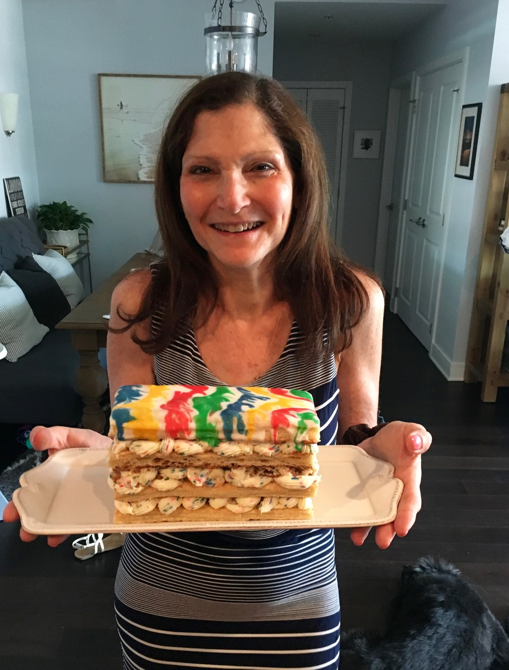 My beautiful mom with her cake.