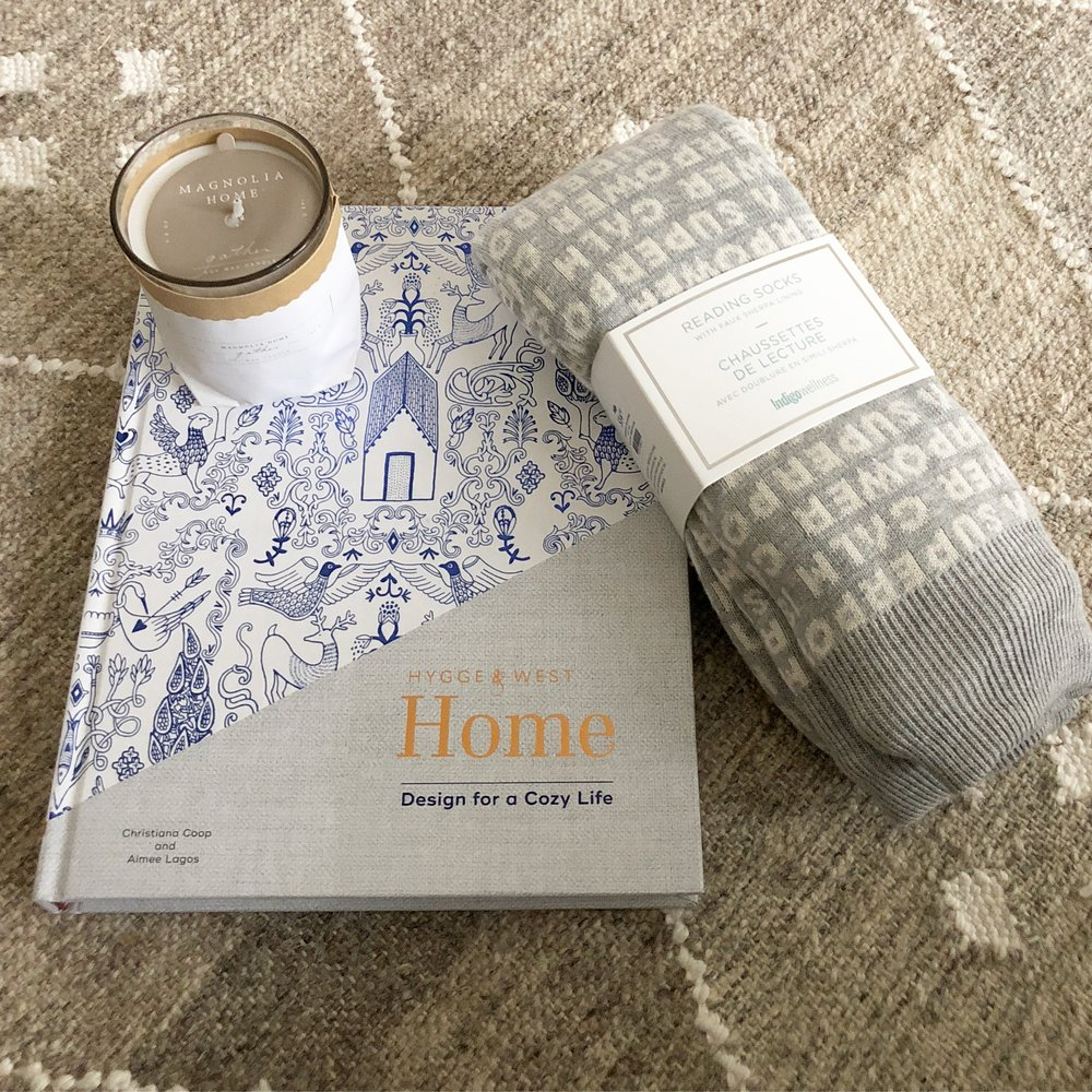"""- Some goodies for me (the newest Hygge&West book, an amazing candle from Magnolia Home, and a pair of """"reading socks"""")…"""