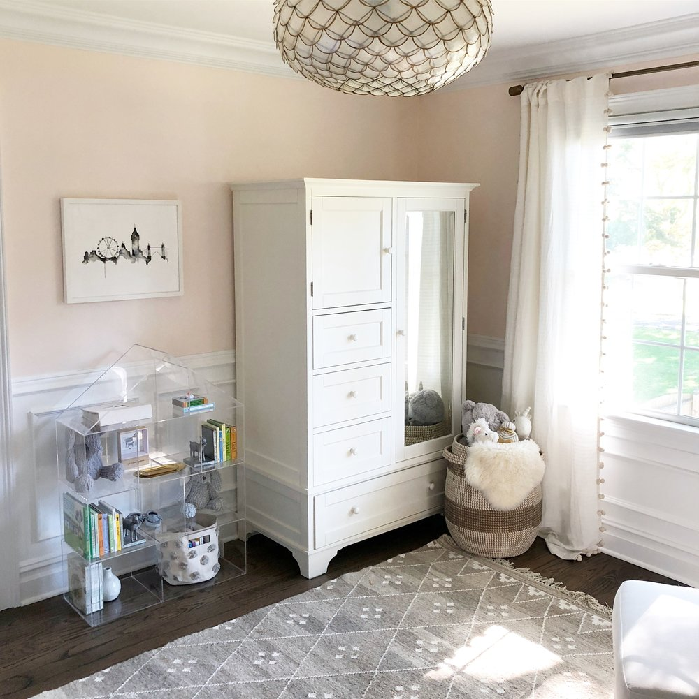 Walls are painted a pale pink and I was able to repurpose this beautiful armoire that we've had for close to 10 years. Add statement pendant lighting and the entire room was transformed!