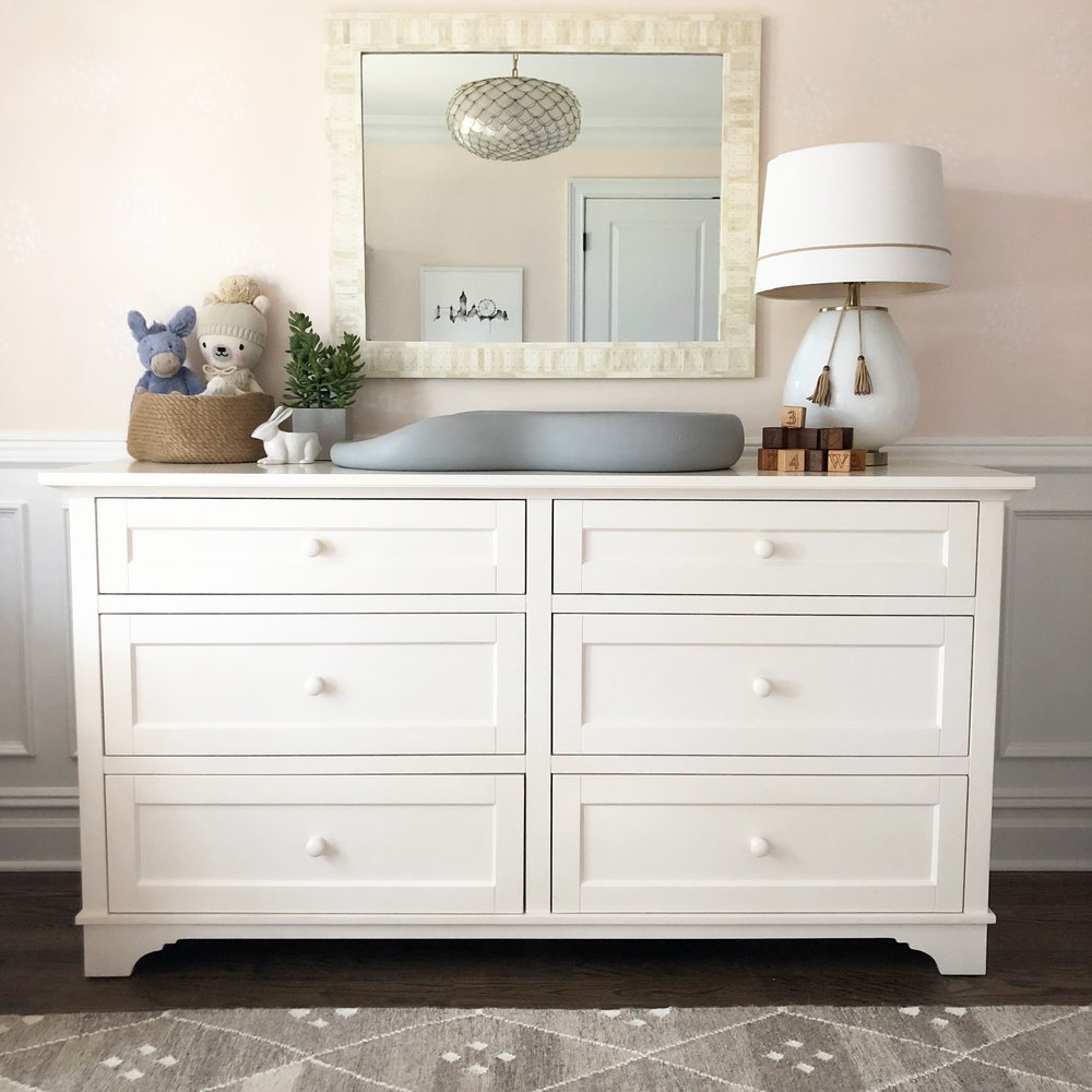 Despite having the armoire for 10 years, we were able to find the matching dresser, which makes for a perfect changing table. I chose a bone inlay mirror to hang above and a simple lamp for extra light.