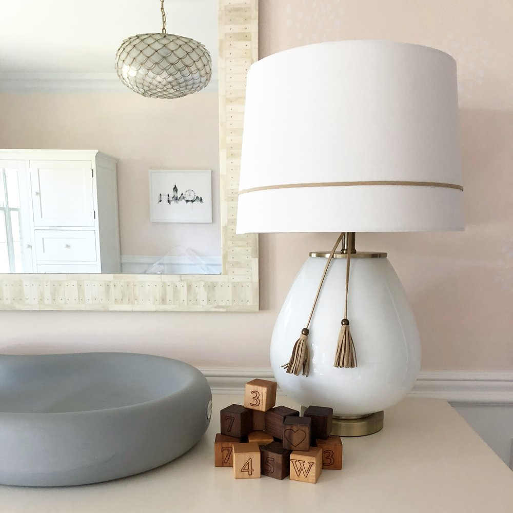 """Close-up of the tassel lamp and my favorite BannorToys blocks (which were originally Jacob's and will still be """"his"""" — but I'm planning to use them for monthly baby photos)."""