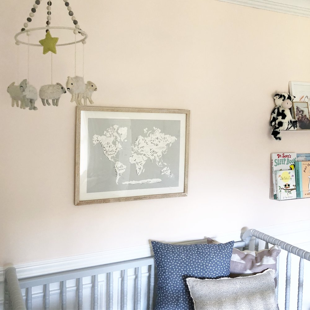 """I chose this """"Beautiful World"""" print to hang above the crib and repurposed Jacob's old mobile, which I think works just as well in this room!"""