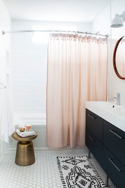 Replacing the shower curtain in your main bath is one inexpensive way to make a design statement. (Photo by  SF Girl by the Bay )