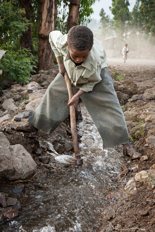 Ethiopia-boy-water-hoe.jpg