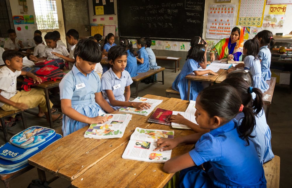 "Teacher Ayesha Parveen works with different groups of learners in her ECL classroom. ""Every student in the class falls into one of three groups,"" she explains. ""Those who can read well, those can read partially by sounding out the words and those who do not even know the letters."" Ayesha calls these the 'green', 'yellow' and 'red' groups. ""Every day I sit and work with two of these groups,"" says Ayesha. ""For example, I work extensively with the red group and using letter cards, I teach them the letters."" In the meantime, she keeps the rest of the groups busy with various creative activities and assignments. ""In this way,"" she says, ""even though we have a lot of students, we can provide them with a quality education."""