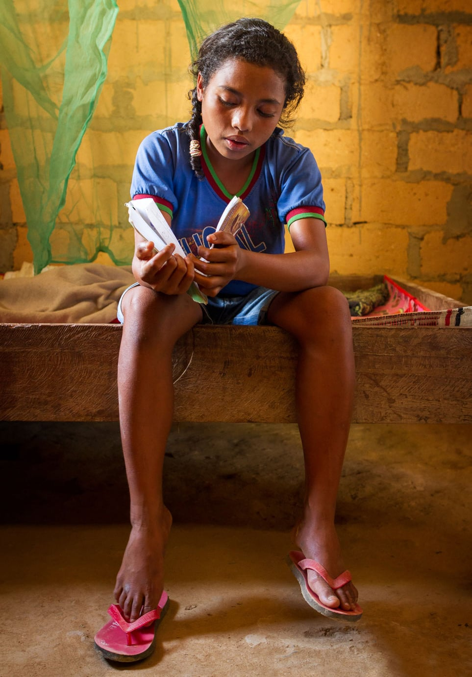 "Aida Mesquita, 14, does her homework. A  ida is in the fifth grade. She is keen to learn, but this was not always the case. Like 30 per cent of children in Timor Leste, Aida had to repeat her first year of school. ""There was no pre-school then so I started school when I was five,"" she says. Aida didn't understand what she was learning and the harsh disciplinary practices of the teachers scared her. After her first year, she dropped out. When her parents convinced her to return two years later, it was to a totally new kind of classroom. The teachers had been trained by UNICEF in child friendly teaching methods that place a premium on child participation. For the first time, Aida liked going to school and learning."