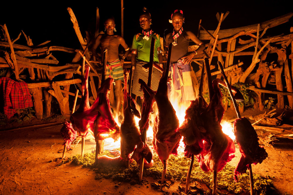 Roasting meat at a Hamar wedding gathering; Omo Valley, Ethiopia